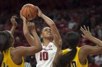 Razorbacks forward/center Kiara Williams (10) reaches for a shot as Grambling State Lady Tigers guard Monisha Neal (4) and forward Alexus Williams (30) cover her during a basketball game on Thursday, December 28, 2017 at Walton Arena in Fayetteville