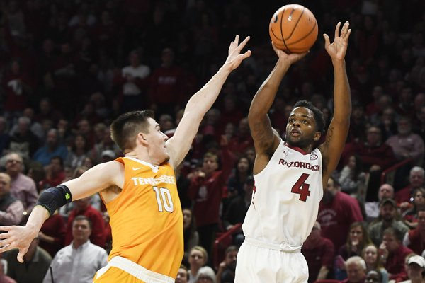 Arkansas guard Daryl Macon pulls ups for a jump shot over Tennessee defender John Fulkerson during the first half of an NCAA college basketball game Saturday, Dec. 30, 2017 in Fayetteville, Ark. (AP Photo/Michael Woods)