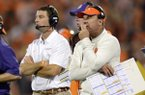 Clemson head coach Dabo Swinney, center, along with defensive coordinator Chad Morris, right, watch the action during the second half of an NCAA college football game against Maryland Saturday, Nov. 10, 2012 at Memorial Stadium in Clemson, S.C. Clemson won 45-10. (AP Photo/Richard Shiro)
