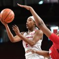Arkansas' Devin Cosper goes up for a shot while Ole Miss' Promise Taylor defends Sunday Dec. 31, 201...