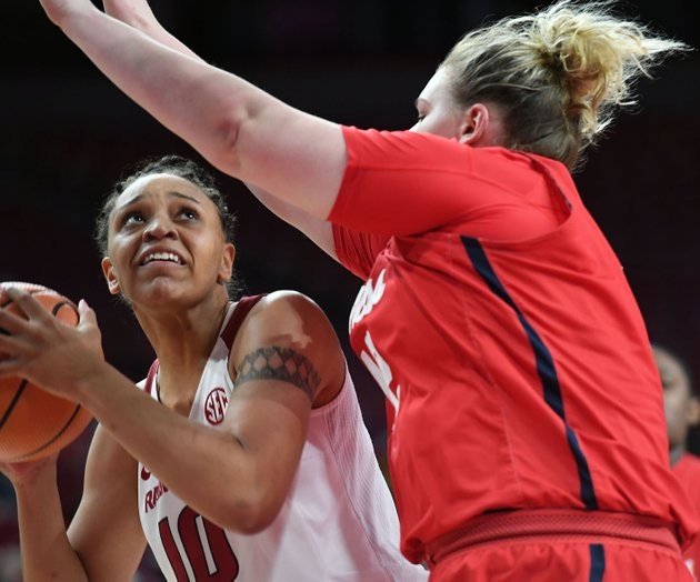 arkansas-kiara-williams-looks-to-shoot-while-ole-miss-shelby-gibson-defends-sunday-dec-31-2017-at-bud-walton-arena-in-fayetteville-arkansas-won-73-72-and-plays-again-at-home-on-jan-7-against-alabama