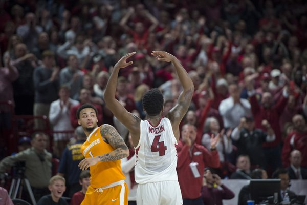 Arkansas Razorbacks guard Daryl Macon (4) waves out to the fans during a basketball game on Saturday, December 30, 2017 at Walton Arena in Fayetteville.