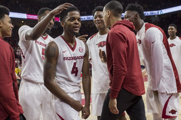 Arkansas Razorbacks players cheer after a play by guard Daryl Macon (4) during a basketball game on Saturday, December 30, 2017 at Walton Arena in Fayetteville.
