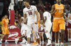 Arkansas forward Daniel Gafford celebrates in front of Tennessee forward Kyle Alexander after the Razorbacks score during the first overtime period of an NCAA college basketball game, Saturday, Dec. 30, 2017 in Fayetteville, Ark. (AP Photo/Michael Woods)
