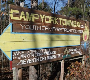 The Sentinel-Record/Richard Rasmussen CAMP PENALIZED: A sign near the entrance to Camp Yorktown Bay, which was penalized in December for exceeding effluent permit limits.