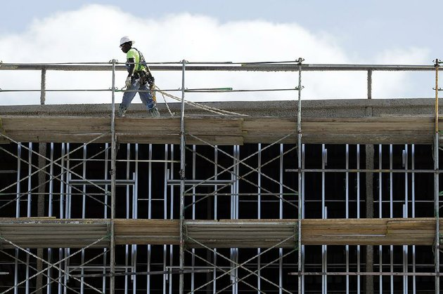 workers-build-an-apartment-and-retail-complex-in-nashville-tenn-in-october-the-commerce-department-said-wednesday-that-private-construction-spending-was-up-1-percent-in-november