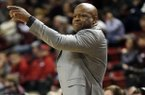 Arkansas head coach Mike Anderson gestures to his team during the first half of their NCAA college basketball game against Mississippi State in Starkville, Miss., Tuesday, Jan. 2, 2018. (AP Photo by Rogelio V. Solis)