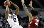 Mississippi State guard Nick Weatherspoon (0) attempts a fall away jumper past an Arkansas defender during the first half of their NCAA college basketball game in Starkville, Miss., Tuesday, Jan. 2, 2018. (AP Photo by Rogelio V. Solis)