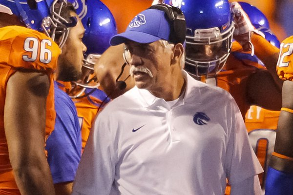 Boise State defensive line coach Steve Caldwell talks with his players during the second half of an NCAA college football game against Fresno State in Boise, Idaho, on Friday, Oct. 17, 2014. Boise State won 37-27. (AP Photo/Otto Kitsinger)