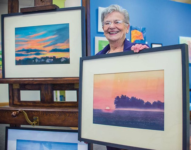 maumelle-artist-mary-ann-stafford-will-be-the-featured-artist-at-art-on-the-green-in-conway-through-feb-7-she-is-shown-here-with-two-of-her-newest-pastel-paintings-in-the-neighborhood-left-and-sarahs-bean-fields-the-public-is-invited-to-meet-stafford-and-view-her-work-at-the-opening-reception-set-for-330-530-pm-thursday
