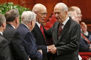 FILE - In this Sept. 30, 2017, file photo, Russell M. Nelson, right, president of the Quorum of the Twelve Apostles, right, greets members of the Quorum, before the start of the morning session of the two-day Mormon church conference, in Salt Lake City. President Thomas S. Monson, of The Church of Jesus Christ of Latter-day Saints, the 16th president of the Mormon church, died Tuesday, Jan. 2, 2018, after nine years in office. He was 90. The next president was not immediately named, but the job is expected to go to next longest-tenured member of the church's governing Quorum of the Twelve Apostles, Nelson, per church protocol. (AP Photo/Rick Bowmer, File)