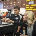 Sara Kennedy helps Nicolas Chagoya, 9, with his research project Nov. 19, 2015, at Monitor Elementar...