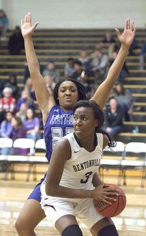 Bentonville High forward Fess Hawkins (3) looks to pass Friday as Fayetteville's Jasmine Franklin defends at Bentonville High School in Bentonville.