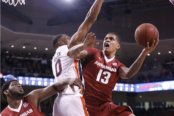 arkansas-forward-dustin-thomas-drives-the-ball-to-the-basket-against-auburn-forward-horace-spencer-during-the-first-half-of-an-ncaa-college-basketball-game-saturday-jan-6-2018-in-auburn-ala-ap-photobrynn-anderson
