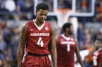 Arkansas guard Daryl Macon reacts to a play during the second half of the team's NCAA college basketball game against Auburn, Saturday, Jan. 6, 2018, in Auburn, Ala. (AP Photo/Brynn Anderson)