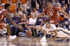 Auburn forward Chuma Okeke (4) dives for the ball against Arkansas forward Daniel Gafford (10) and Arkansas guard Daryl Macon (4) during the first half of an NCAA college basketball game, Saturday, Jan. 6, 2018, in Auburn, Ala. (AP Photo/Brynn Anderson)