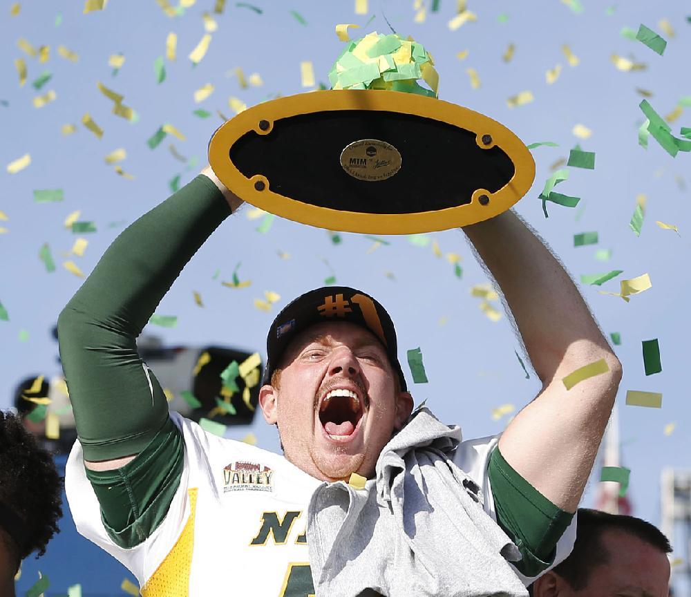 North Dakota State Long Snapper James Fisher Celebrates With Teammates