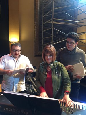 """Tom Karounos as Max Bialystock, left, and Patrick Edmunds as Leo Bloom, right, begin rehearsals for the Arkansas Public Theatre production of """"The Producers"""" with musical director/conductor Lisa Auten."""