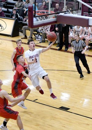 Bud Sullins/Special to Siloam Sunday Siloam Springs senior Diego Flores takes the ball to the basket during the second half of the Panthers' 64-59 victory against Farmington on Wednesday at Panther Activity Center.