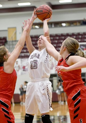Bud Sullins/Special to Siloam Sunday Siloam Springs sophomore Shelby Johnson shoots over a pair of Farmington defenders during Wednesday's game at the Panther Activity Center.