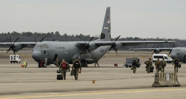 file-airmen-walk-across-the-flight-line-to-their-c-130j-on-jan-7-2018-at-little-rock-air-force-base-in-jacksonville