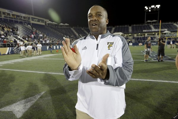 Florida International interim coach Ron Cooper applauds as he walks off the field after the team's NCAA college football game against Marshall, Saturday, Nov. 19, 2016, in Miami. Florida International won 31-14. (AP Photo/Lynne Sladky)