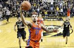 Florida's Chris Chiozza (11) heads to the basket to score the game-winning shot as time expires in an NCAA college basketball game against Missouri, Saturday, Jan. 6, 2018, in Columbia, Mo. Florida won 77-75. (AP Photo/Jeff Roberson)