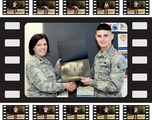 lt-col-tiffany-feet-19th-aircraft-maintenance-squadron-commander-presents-airman-1st-class-zachary-perkins-19th-aircraft-maintenance-squadron-crew-chief-a-certificate-for-achieving-runner-up-status-in-the-2017-air-force-entertainer-of-the-year-group-1-nonvocal-category-on-dec-13-at-the-little-rock-air-force-base-perkins-a-four-year-animation-dancer-danced-to-voice-of-reason-by-haywire-in-the-online-video-talent-contest-sponsored-by-the-air-force-services-activity