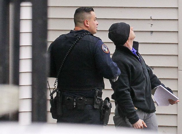 little-rock-police-detectives-examine-bullet-holes-in-the-wall-of-eastview-terrace-apartments-on-east-13th-and-geyer-streets-where-a-man-was-fatally-shot-monday-afternoon