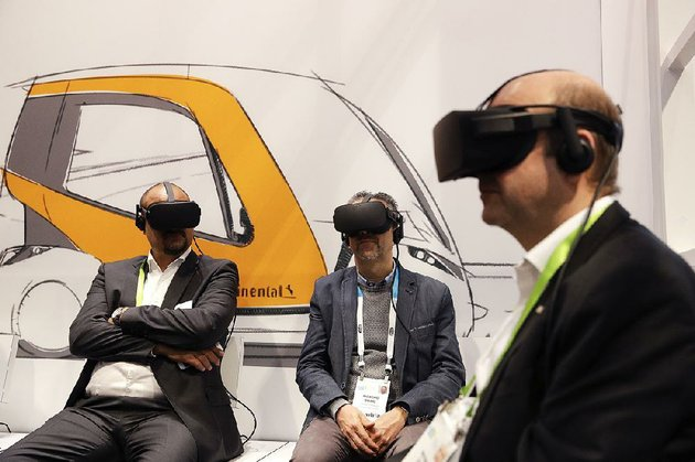 attendees-watch-a-presentation-wearing-virtual-reality-headsets-at-the-technology-company-continentals-booth-at-the-ces-international-gadget-show-tuesday-in-las-vegas
