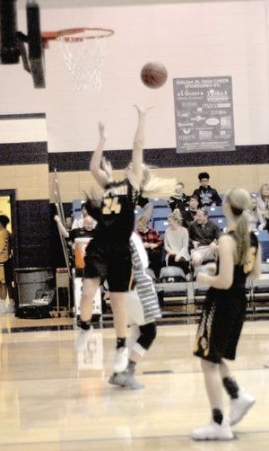 MARK HUMPHREY ENTERPRISE-LEADER Prairie Grove senior Sarah James Stone finishes a strong move in the paint during the Lady Tigers' 43-40 win over Shiloh Christian Tuesday, Jan. 2.