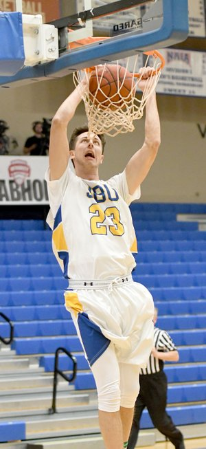 Bud Sullins/Special to the Herald-Leader John Brown freshman Rokas Grabliauskas goes up for a two-handed dunk during the first half of Saturday's game against Panhandle State.