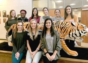 Submitted photo Prairie Grove celebrates Color's Day this week. The pep rally starts at 1:15 p.m. on Friday and the coronation ceremony will be around 6:30 Friday evening. The Tigers host Elkins Friday in basketball competition. Colors Day maids are front row (from left): senior maids Maria Luisa Akey, Glory Parrish, and Eralise Mauk. Back row: freshman maid Kelsey Pickett, sophomore maid Aniyah Gibbs, junior maids Whitney Walker and Edie Mills, sophomore maid Brenna Spradley, and freshman maid Alyssa LeDuc.