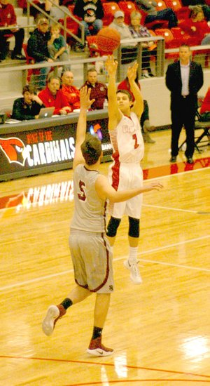 Mark Humphrey/Enterprise-Leader Uncovered by the Siloam Springs defense, Farmington senior Matt Wilson launches a deep 3-pointer on his way to a school-record 49 points during a Jan. 3 contest won by the Cardinals, 70-48. Wilson made five 3-point shots all in the first half.