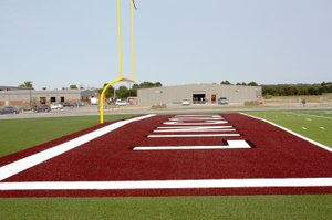 MARK HUMPHREY ENTERPRISE-LEADER Lincoln's new Football Fieldhouse is located behind the high school and just east of the north end zone which is brightly colored in Lincoln's maroon and white school colors as part of the artificial turf installed at Wolfpack Stadium.