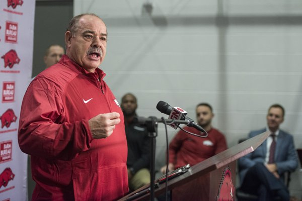 Arkansas defensive coordinator John Chavis speaks during a news conference Wednesday, Jan. 10, 2018, in Fayetteville. Arkansas head coach Chad Morris can be seen in the background on the far right.