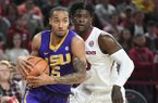LSU's Daryl Edwards drives to the basket in front of Arkansas' Jaylen Barford during an NCAA college basketball game Wednesday, Jan. 10, 2018, in Fayetteville.