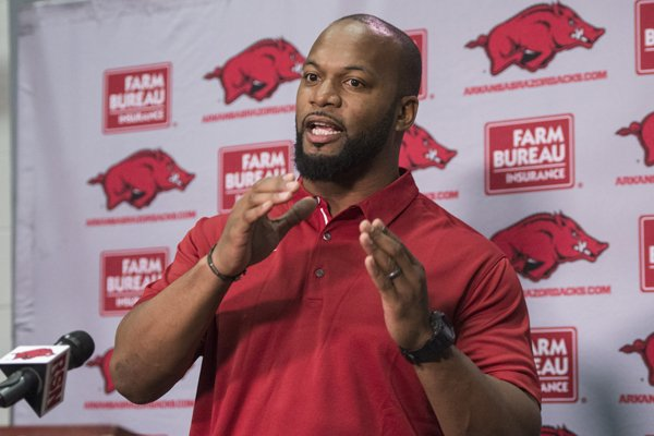Arkansas strength and conditioning coach Trumain Carroll speaks during a news conference Wednesday, Jan. 10, 2018, in Fayetteville. Carroll is one of several former SMU staff members who have followed Razorbacks coach Chad Morris to Arkansas.
