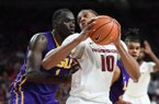 Arkansas center Daniel Gafford tries to turn to the basket while he is defended by LSU forward Duop Reath during a game Wednesday, Jan. 10, 2018, in Fayetteville.