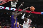 Arkansas guard Jaylen Barford has a shot contested by LSU forward Duop Reath during a game Wednesday, Jan. 10, 2018, in Fayetteville.