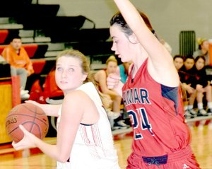 RICK PECK/SPECIAL TO MCDONALD COUNTY PRESS McDonald County's Megan Mills looks to score while being defended by Lamar's Lauren Compton during the Lady Mustangs' 44-37 loss on Jan. 4 at MCHS.
