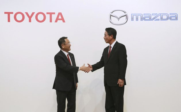 file-in-this-aug-4-2017-file-photo-toyota-motor-corp-president-akio-toyoda-left-and-mazda-motor-corp-president-masamichi-kogai-shake-hands-after-a-press-conference-in-tokyo-japanese-automakers-toyota-and-mazda-have-picked-alabama-as-the-site-of-a-new-16-billion-joint-venture-auto-manufacturing-plant-a-person-briefed-on-the-decision-said-tuesday-jan-9-2018-ap-photoeugene-hoshiko-file