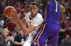 Arkansas center Daniel Gafford looks to drive past LSU forward Duop Reath during a game Wednesday, Jan. 10, 2018, in Fayetteville.