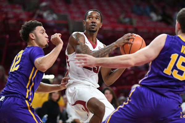 Arkansas guard C.J. Jones looks for a shot during a game against LSU on Wednesday, Jan. 10, 2018, in Fayetteville.