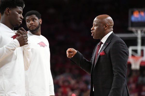 Arkansas coach Mike Anderson talks to players prior to a game against LSU on Wednesday, Jan. 10, 2018, in Fayetteville.