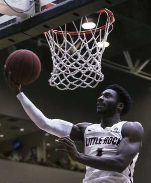 UALR's Andre Jones goes for a shot against Texas Arlington on Thursday at Jack Stephens Center in Little Rock. Jones finished with a team-high 24 points.