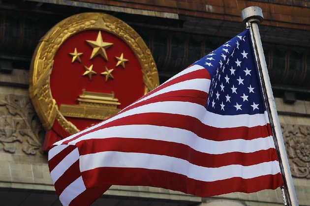 an-american-flag-flies-at-the-great-hall-of-the-people-in-beijing-during-president-donald-trumps-visit-in-november-on-thursday-china-objected-to-a-us-investigation-of-suspected-unfair-trade-practices