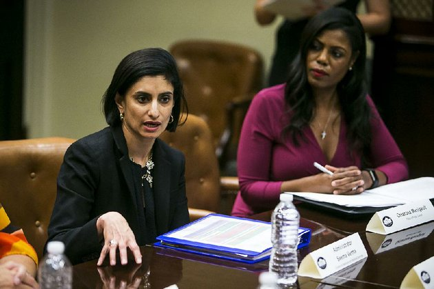 seema-verma-left-administrator-of-the-centers-for-medicare-and-medicaid-services-is-shown-with-former-white-house-aide-omarosa-manigault-during-a-health-and-human-services-listening-session-on-the-affordable-care-act-in-the-roosevelt-room-of-the-white-house-june-21-2017