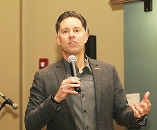 Matt Osborne, senior vice president for rescue and rehabilition for the Operation Underground Railroad, speaks to a group gathered for a conference addressing human trafficking at National Park Collge Thursday, Janaury 11, 2018. (The Sentinel-Record/Richard Rasmussen)