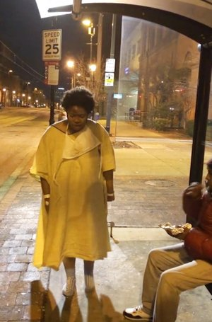 Imamu Baraka via AP This Tuesday, Jan. 9, 2018, still image taken from video provided by Imamu Baraka shows a woman discharged from a Baltimore hospital wearing only a gown and socks on a cold winter's night. Baraka, identified in local reports as the person who sought to help the woman, told The Associated Press he was so angry he decided to record Tuesday night's events on cellphone video, fearing no one would believe him if he reported a woman being left at a bus stop like that.